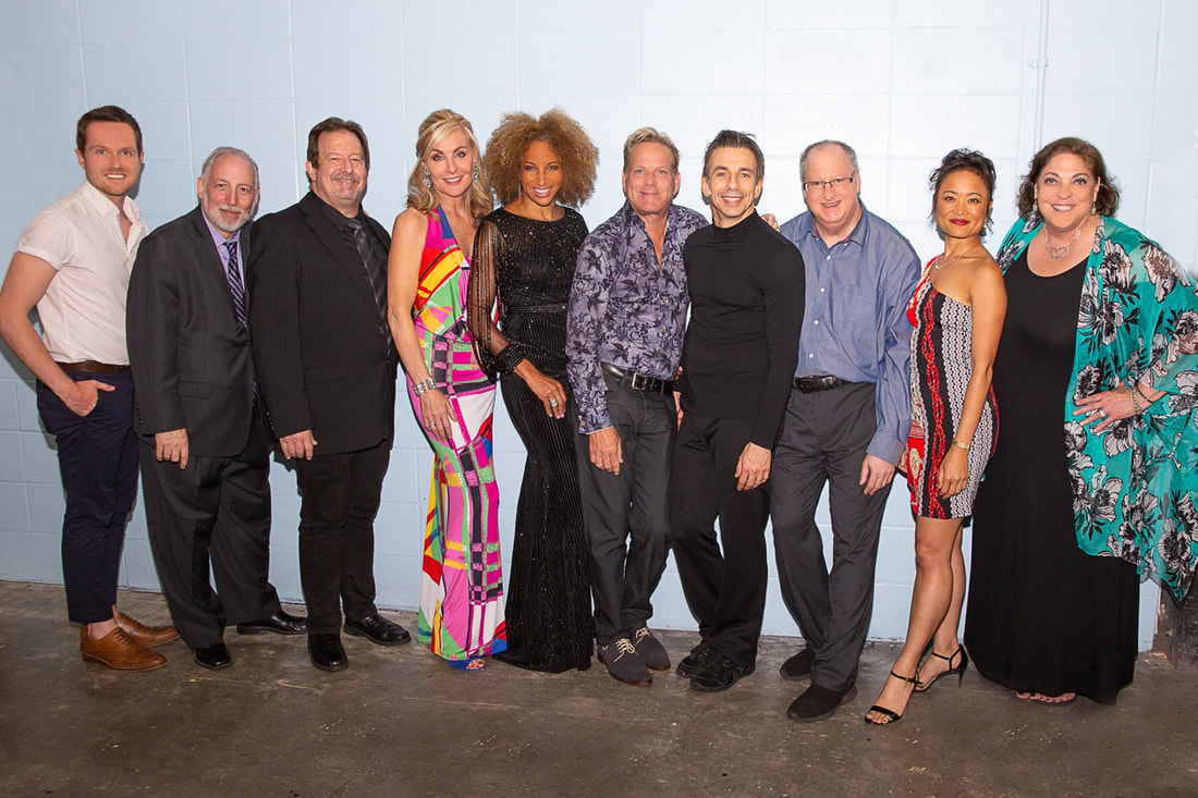 The Cast & Management of Broadway Spotlight take a photo backstage